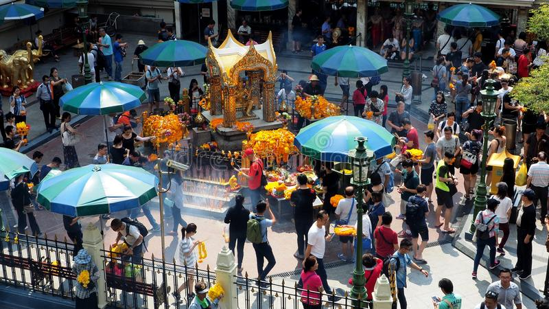 Foreigners and local people visit the Erawan Shrine royalty free stock photography