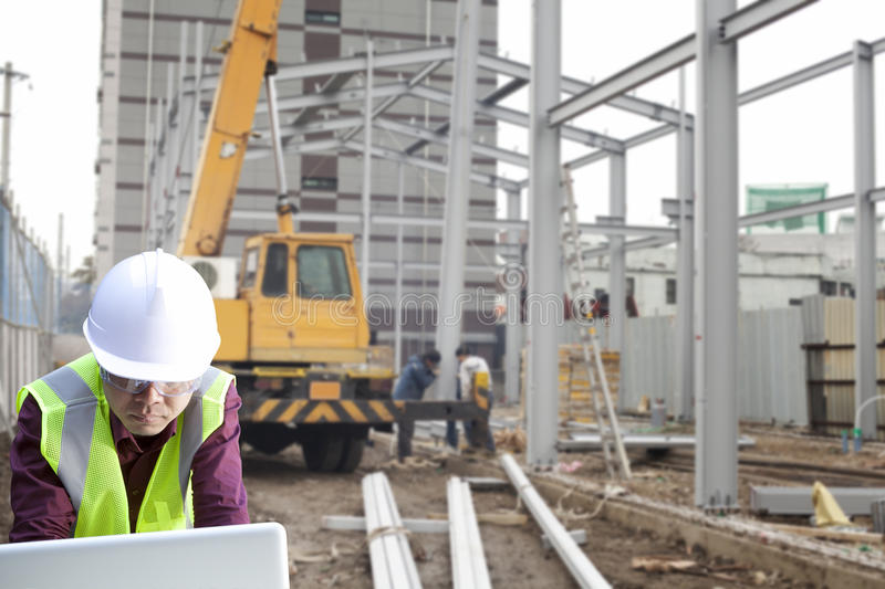 Download Foreman Construction Site Using Laptop Stock Image - Image: 28363565