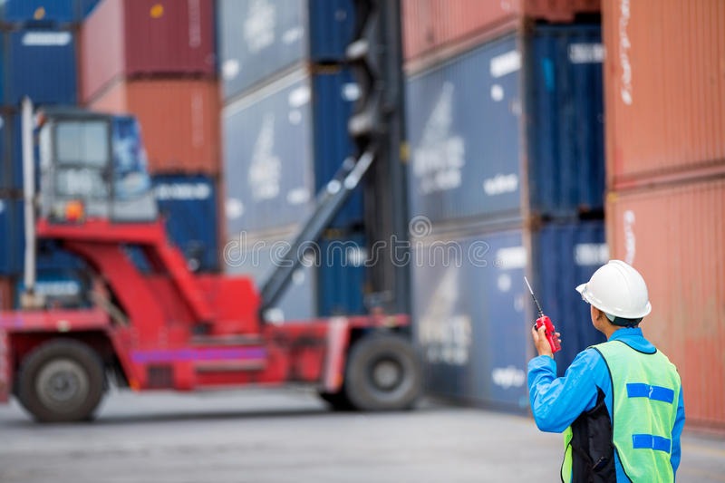 Foreman control forklift handling the container box stock photography