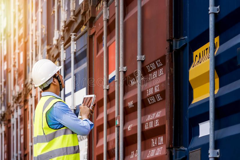 Foreman control loading Containers box from Cargo stock image