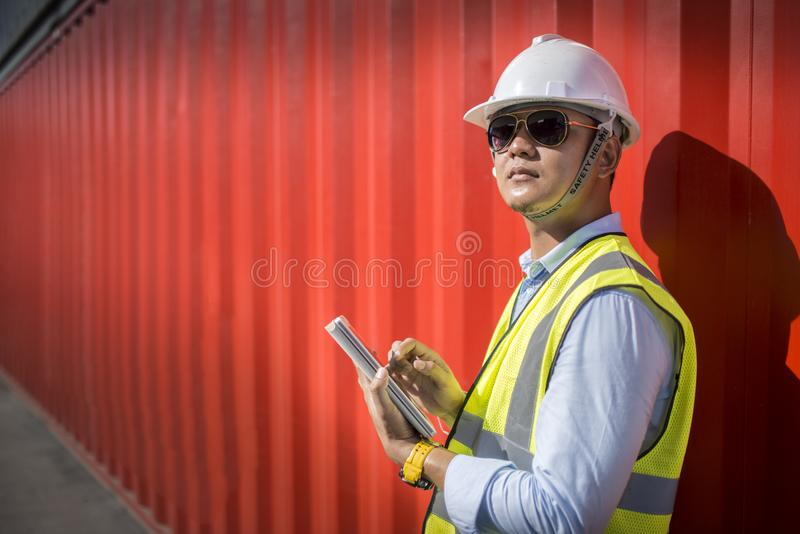 Foreman control loading containers box from cargo freight ship for import export, Foreman control industrial container cargo freig royalty free stock photography
