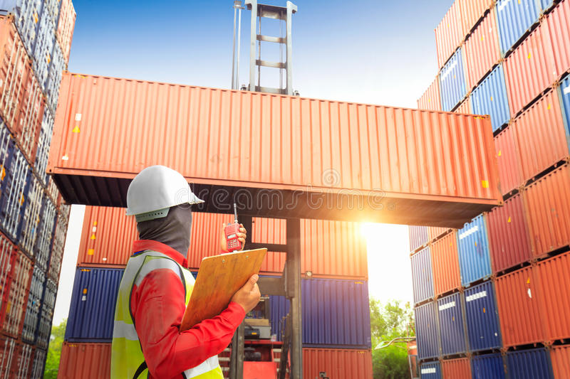 Foreman control loading Containers box to truck for Logistic Imp. Ort Export Background, Business logistic concept royalty free stock photography