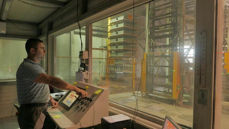 Foreman Controls The Production From The Operator's Room On A ...