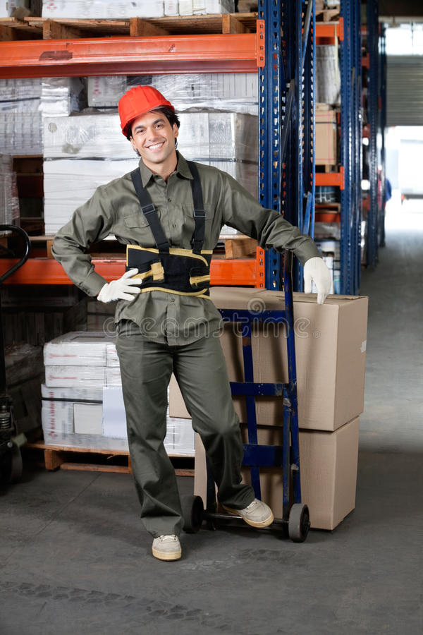 Foreman With Handtruck Loading Cardboard Boxes stock photography