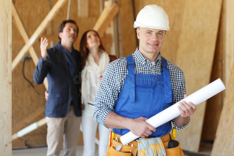Foreman with house design plans stock photography