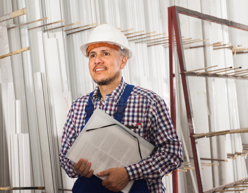 Foreman inspecting production output at modern factory stock photos
