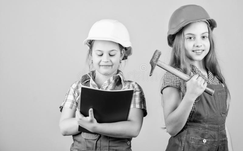 Foreman inspector. Repair. happy children. Future career. Little kids in helmet with tablet and hammer. Labor day. 1 may stock images
