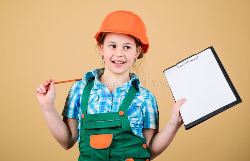 Foreman inspector. Repair. small girl repairing in workshop. Child care development. Safety expert. Future profession. Builder engineer architect. Kid worker stock photos