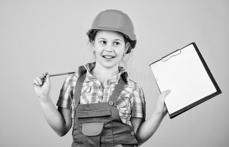 Foreman inspector. Repair. small girl repairing in workshop. Child care development. Safety expert. Future profession. Builder engineer architect. Kid worker royalty free stock photography