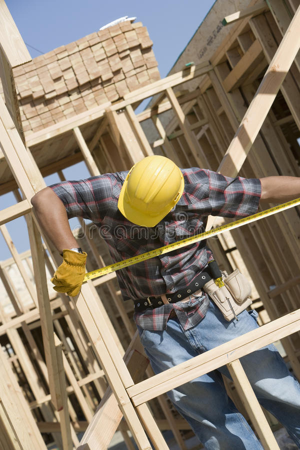 Foreman Measuring Framework At Construction Site royalty free stock images