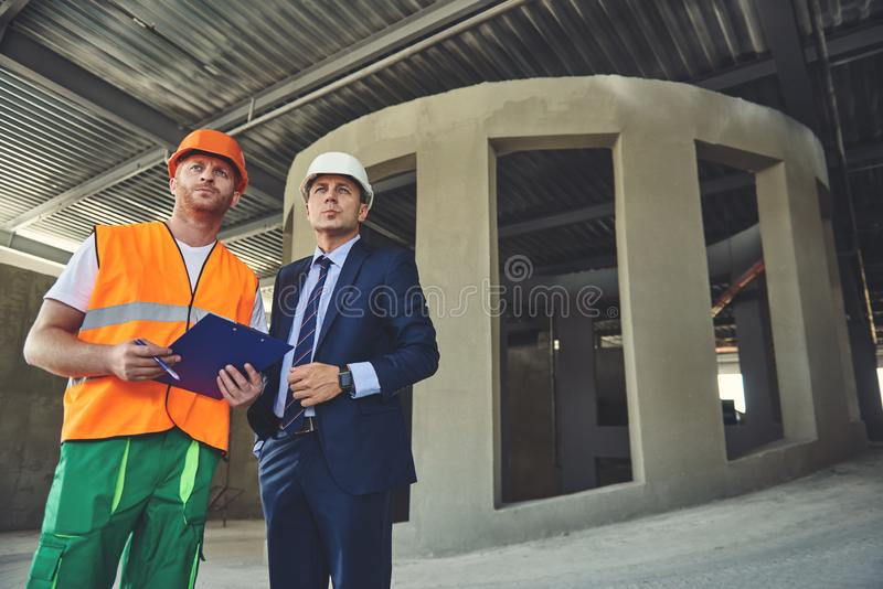 Foreman with project manager in working process royalty free stock photo