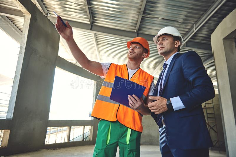 Project manager is communicating with worker man stock image