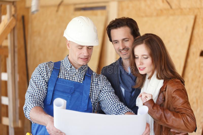 Foreman shows house design plans stock photos