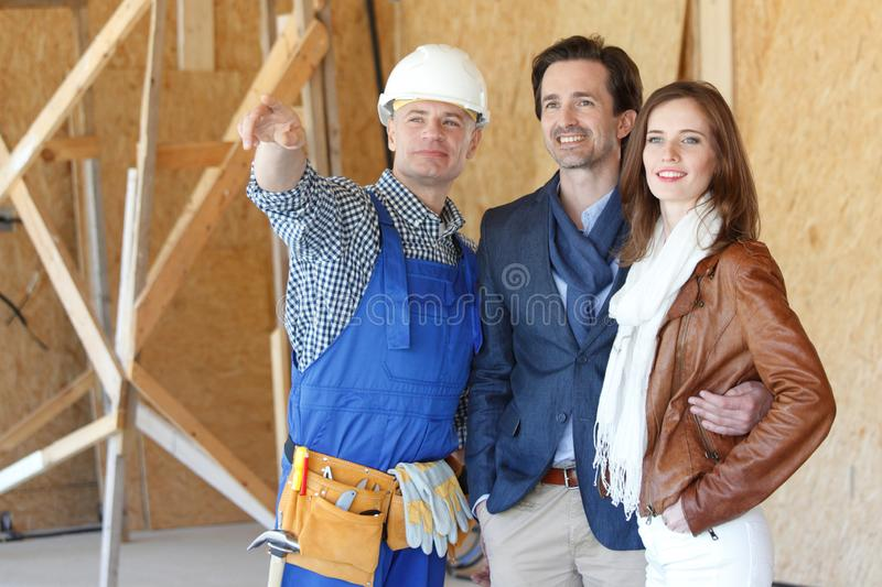 Foreman shows new house royalty free stock image