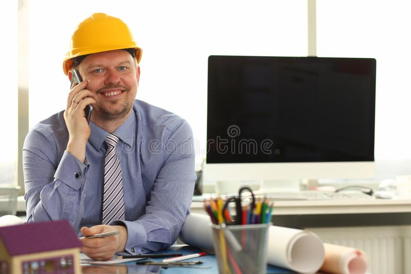 Foreman Sketching Architect Blueprint Making Deal royalty free stock images