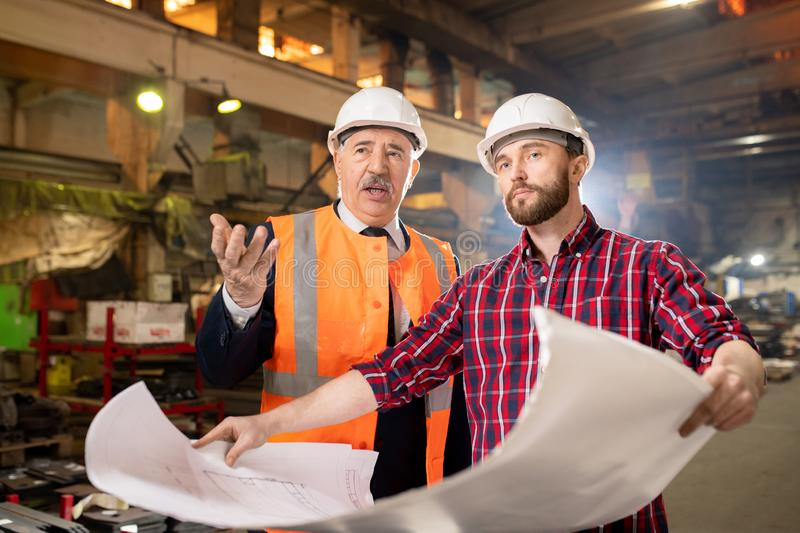 Foreman and subordinate stock image