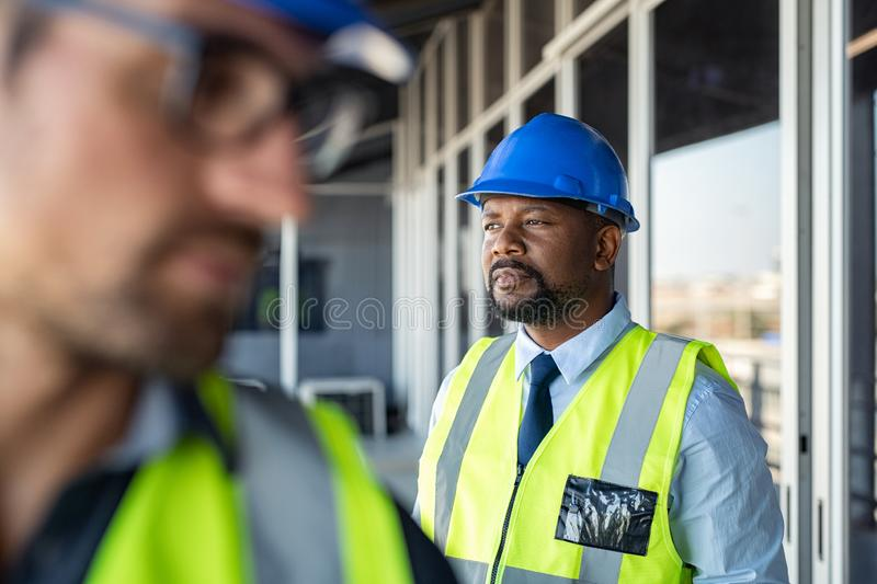 Foreman thinking at construction site royalty free stock photos