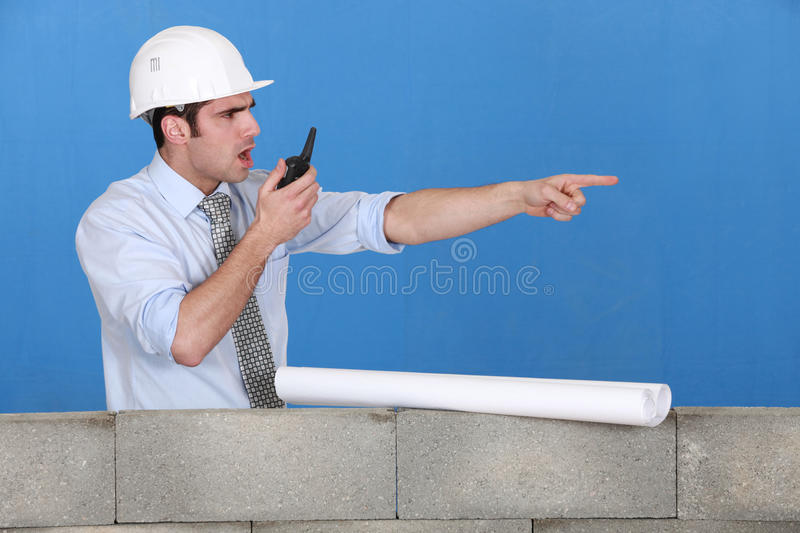 Foreman with a walkie talkie stock image
