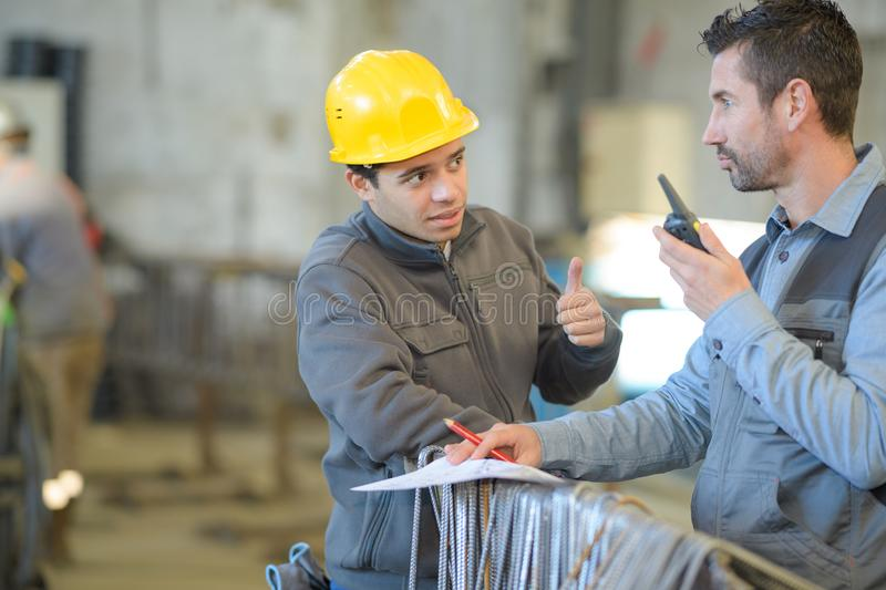 Foreman at work using walkie-talkie. Foreman at work using a walkie-talkie stock photo