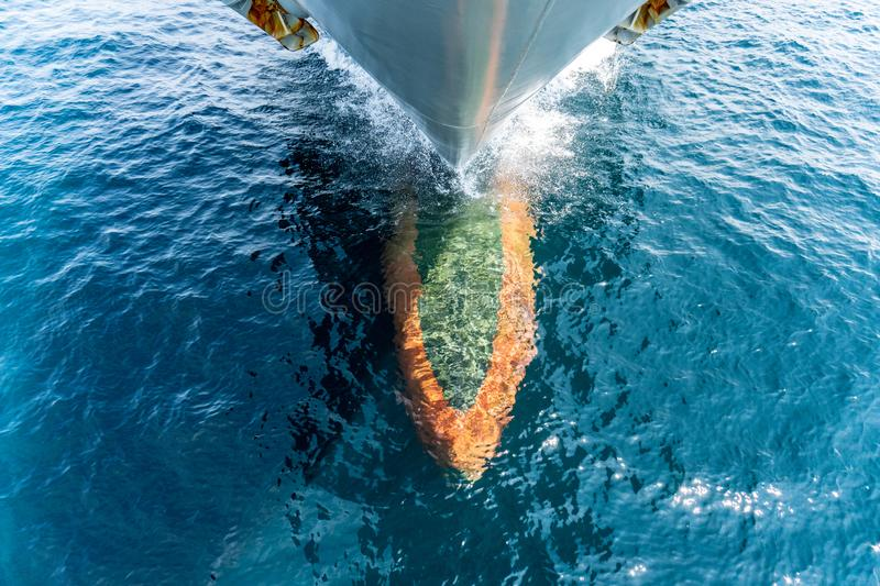 Foremost part of the warship sailing in the sea that show bulbous bow, stem and anchores hanging at the both side.  stock photos