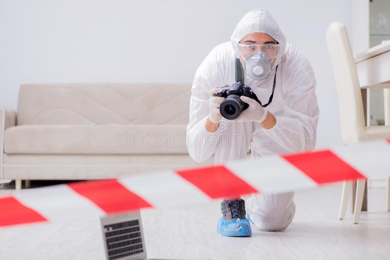The forensic expert at crime scene doing investigation. Forensic expert at crime scene doing investigation royalty free stock photo