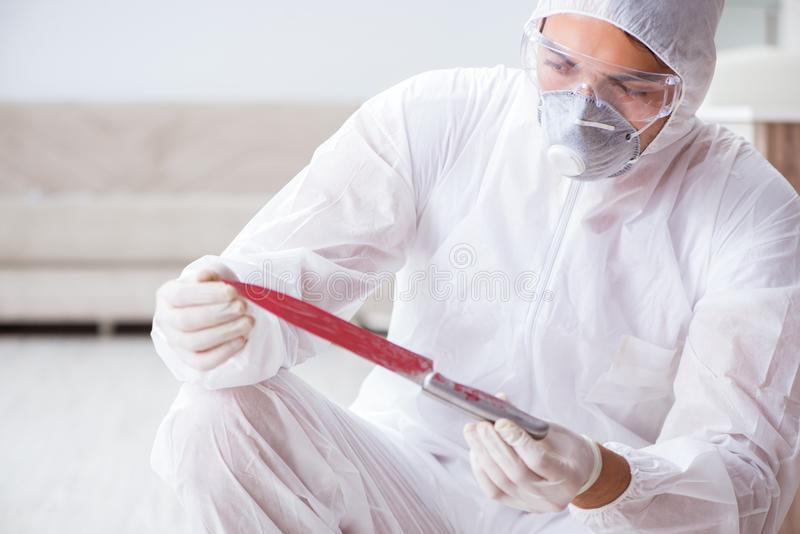 The forensic expert at crime scene doing investigation. Forensic expert at crime scene doing investigation stock photography