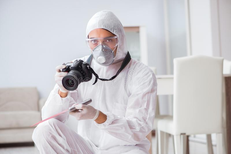 The forensic expert at crime scene doing investigation. Forensic expert at crime scene doing investigation stock images