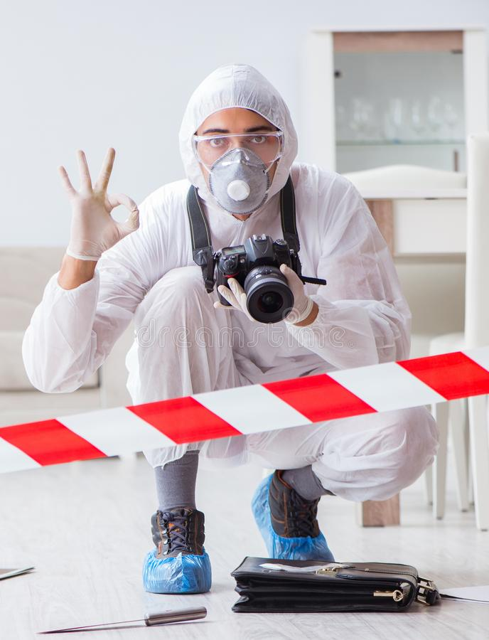 Forensic expert at crime scene doing investigation. The forensic expert at crime scene doing investigation royalty free stock image