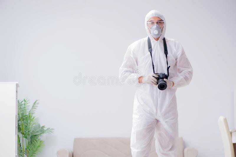 The forensic expert at crime scene doing investigation. Forensic expert at crime scene doing investigation stock photo