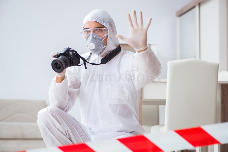 The forensic expert at crime scene doing investigation. Forensic expert at crime scene doing investigation royalty free stock image