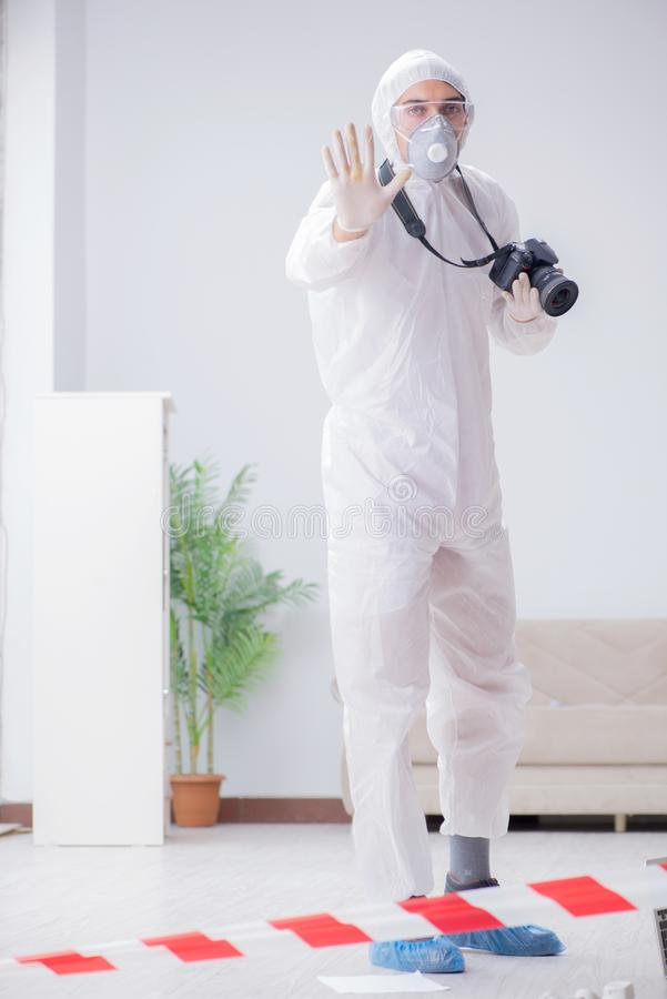 The forensic expert at crime scene doing investigation. Forensic expert at crime scene doing investigation royalty free stock photos