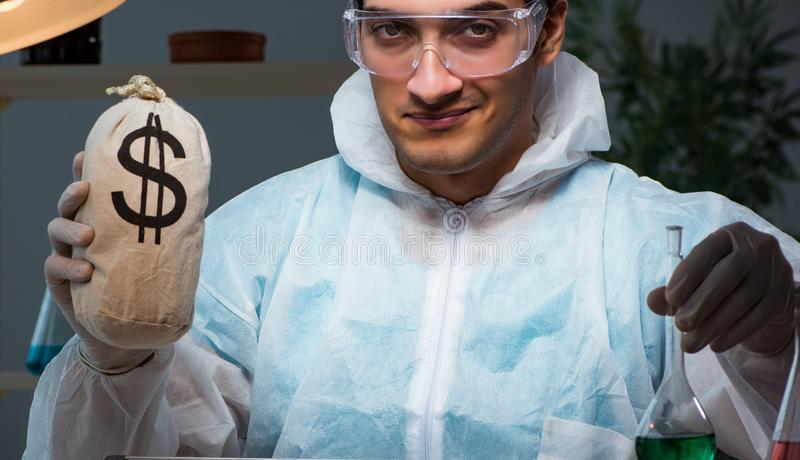 Forensic investigator working in lab looking for evidence. The forensic investigator working in lab looking for evidence stock image