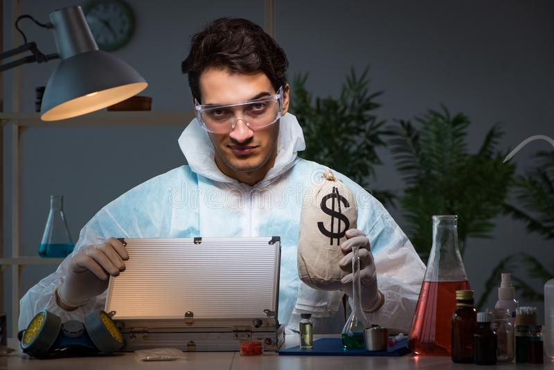 The forensic investigator working in lab looking for evidence. Forensic investigator working in lab looking for evidence stock photo
