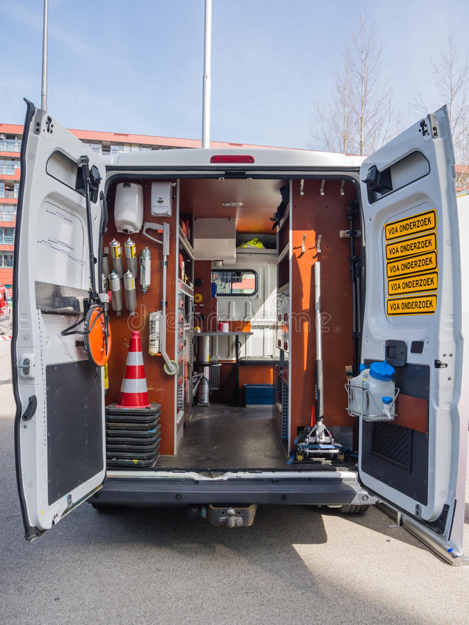 Forensic police van. ALMERE, NETHERLANDS - 12 APRIL 2014: Look inside a van of the Dutch forensic investigation service on display during the first National stock images