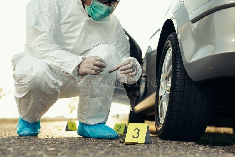 Forensic Science. Criminologist investigates a crime scene. Forensic Science.Young  Criminologist investigates a crime scene royalty free stock photos