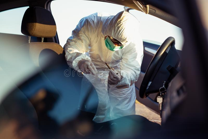 Forensic Science. Criminologist investigates a crime scene. royalty free stock photo