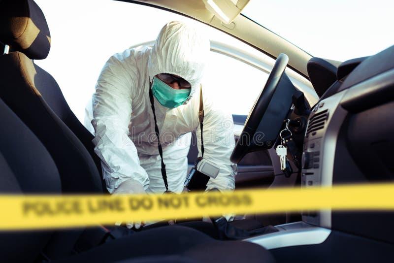 Forensic Science. Criminologist investigates a crime scene. Forensic Science.Young  Criminologist investigates a crime scene stock photography