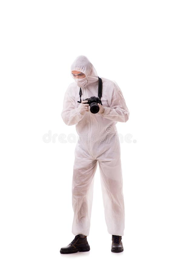 The forensic specialist in protective suit taking photos on white. Forensic specialist in protective suit taking photos on white stock photos