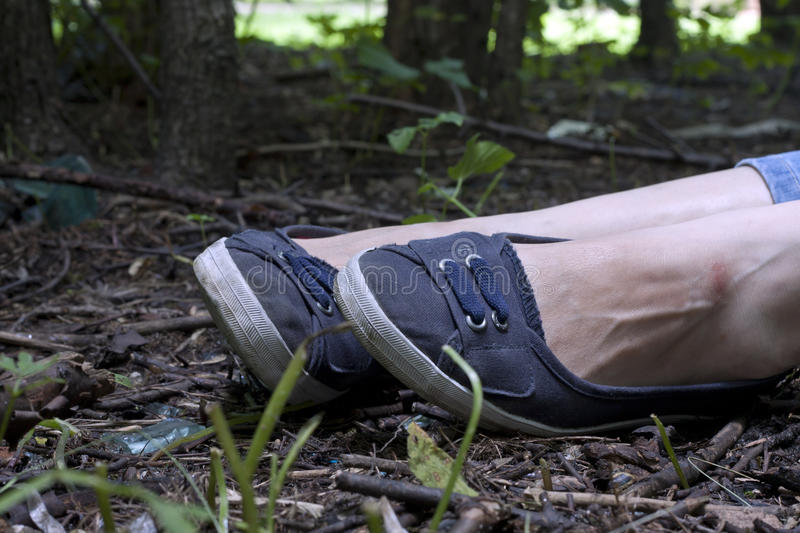 Forensics and investigation girl legs in the forest