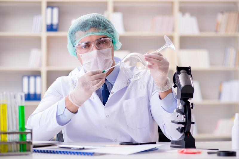 The forensics investigator working in lab on crime evidence stock images