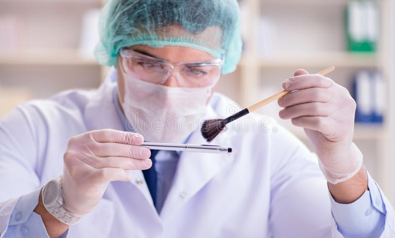 Forensics investigator working in lab on crime evidence. The forensics investigator working in lab on crime evidence royalty free stock images