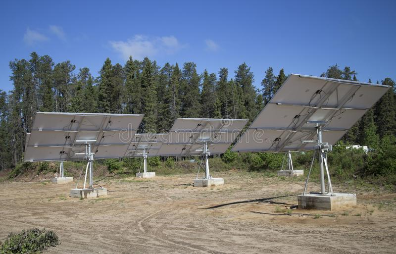 Forest alternative energy. Solar panels facing the sky in wild northern canadian forest royalty free stock photo