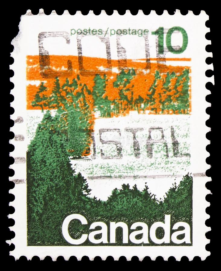 Forest area in central Canada, Definitives 1972-77 serie, circa 1976. MOSCOW, RUSSIA - SEPTEMBER 22, 2019: Postage stamp printed in Canada shows Forest area in stock photography