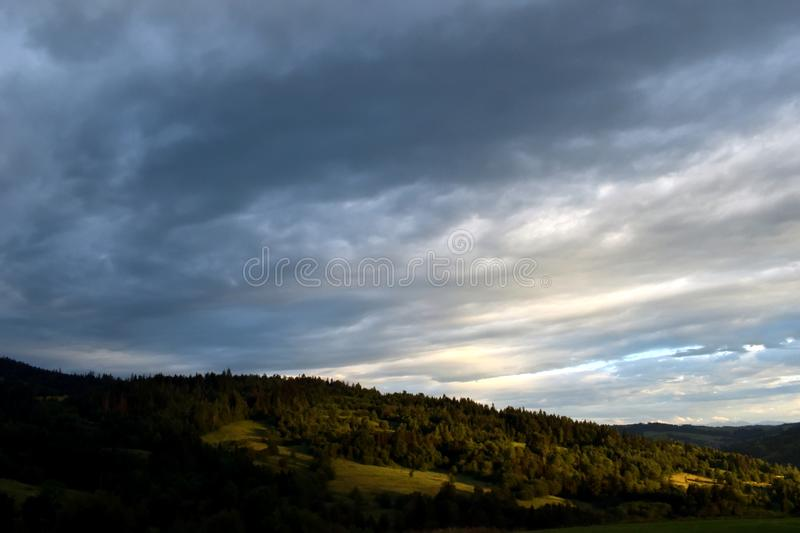 Forest & clouds royalty free stock photography