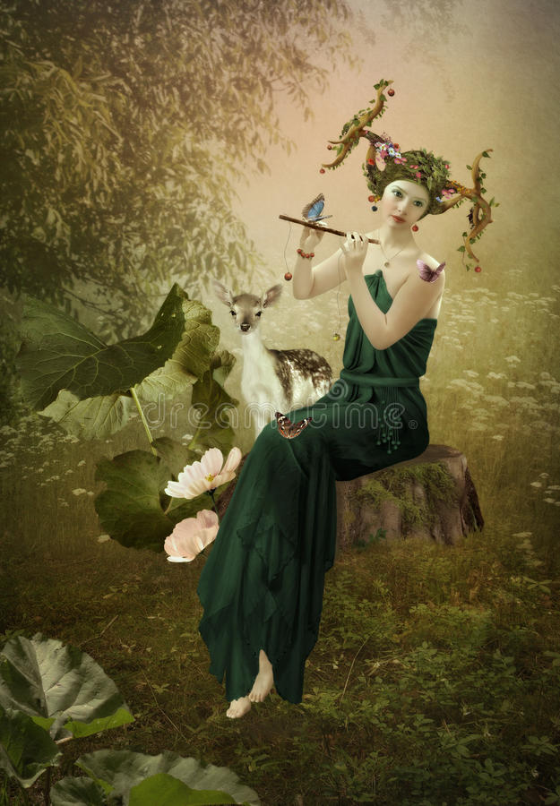 Forest Fairy Tale. Young girl with antlers on her head is playing the flute sitting on the stump in forest surrounded by butterflies and fawn.Forest Diva royalty free stock photo
