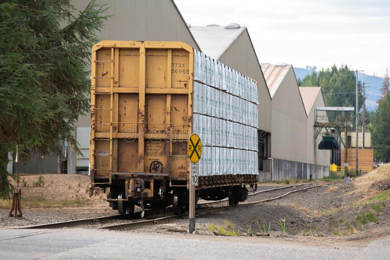 Cargo train car loaded with lumber stock image