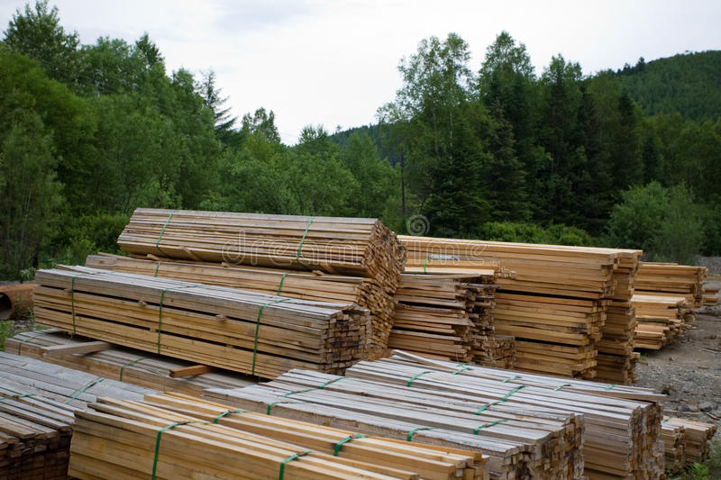 Forest industry. Sawn wood planks, stockpiled in the lumber yard stock photo