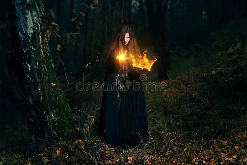 Forest keeper casting fire magic stock photography