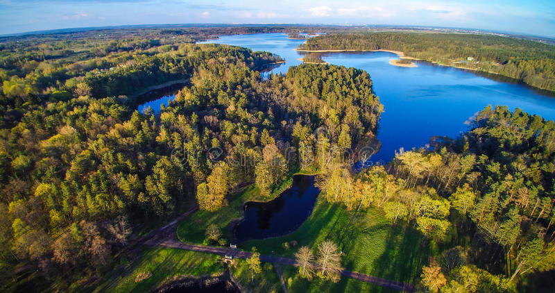 Forest and lake from bird's view. Lithuania, lake Skaistis, Uzutrakis royalty free stock photography