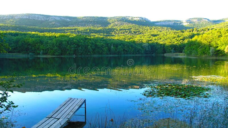 Forest lake in the Crimean mountains. Sunset. Crimea royalty free stock image